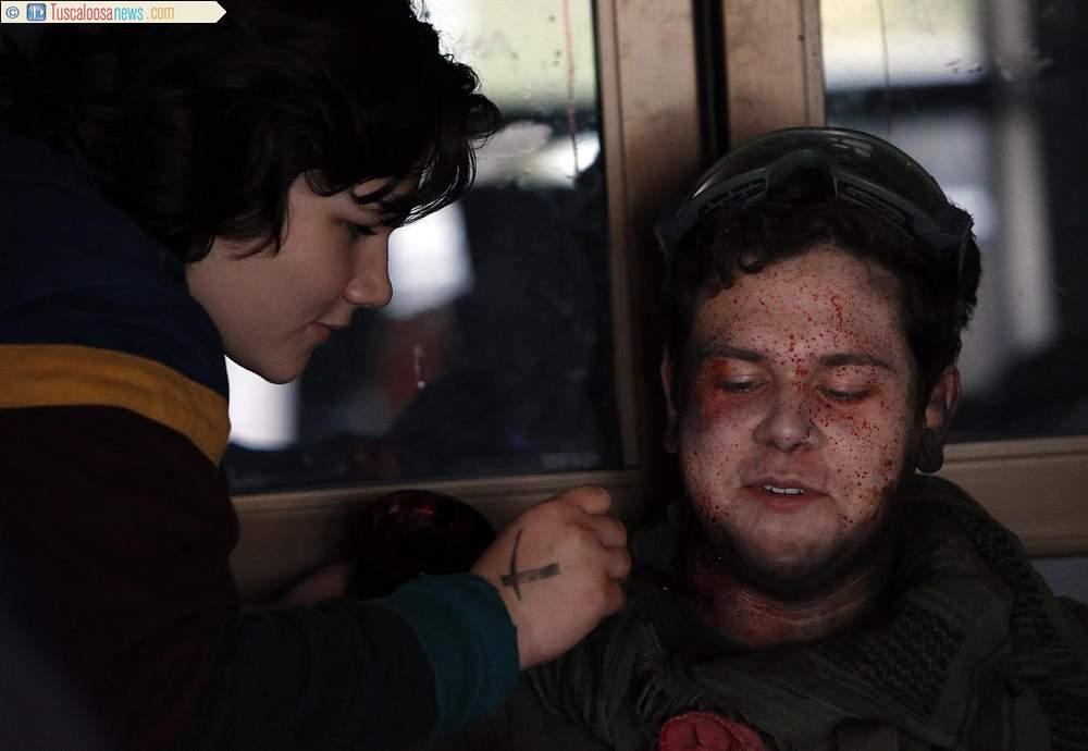 Katie Hooper applying zombie makeup for the Zom-Com TV pilot.